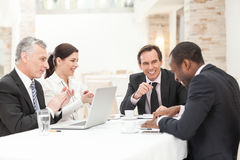 Happy Business People In Meeting Stock Image