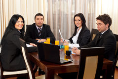 Happy business people at meeting table Royalty Free Stock Photo