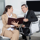 Happy business people with order Stock Photo