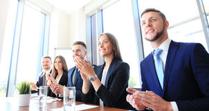Happy business people. Photo of happy business people applauding at conference Royalty Free Stock Images