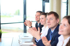 Happy business people. Photo of happy business people applauding at conference, focus on smiling girl Royalty Free Stock Photo