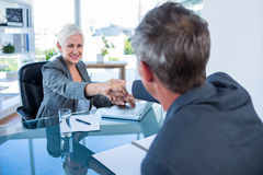 Happy business people shaking hands Royalty Free Stock Images