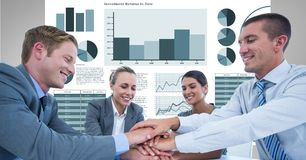 Happy business people stacking hands against graphs. Digital composite of Happy business people stacking hands against graphs Stock Photography