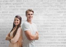 Happy business people standing against white wall Royalty Free Stock Photos