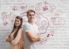 Happy business people standing against white wall with graphics Stock Images