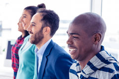 Happy business people standing in row Stock Images
