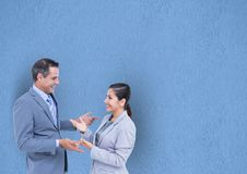 Happy business people talking against blue background Royalty Free Stock Photos