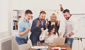 Happy business people team celebrate success in the office Stock Image