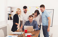 Happy business people team together have fun in office. Happy business people laugh near laptop in the office. Successful corporate team of female and male Royalty Free Stock Image