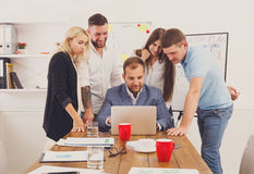 Happy business people team together with laptop in office Royalty Free Stock Image