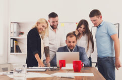 Happy business people team together look at laptop in office Royalty Free Stock Image