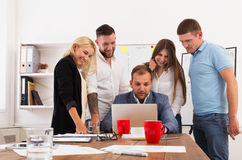 Happy business people team together look at laptop in office Royalty Free Stock Photo