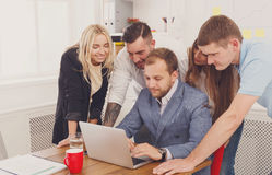 Happy business people team together near laptop in office Stock Photos