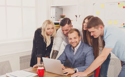 Happy business people team together near laptop in office Stock Photo