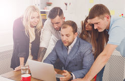 Happy business people team together near laptop in office Stock Image