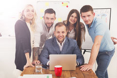 Happy business people team together near laptop in office Royalty Free Stock Images