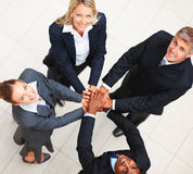 Happy business people with their hands togeher Royalty Free Stock Images