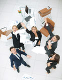 Happy business people throw into the air the documents Stock Image