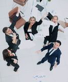 Happy business people throw into the air the documents. Successful business team throws into the air the documents Royalty Free Stock Photos