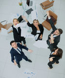 Happy business people throw into the air the documents. Successful business team throws into the air the documents Stock Photo