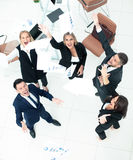 Happy business people throw into the air the documents. Successful business team throws into the air the documents Royalty Free Stock Images