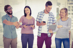 Happy business people using electronic gadgets Royalty Free Stock Image