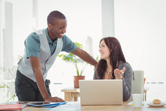 Happy Business people using laptop at desk Stock Image