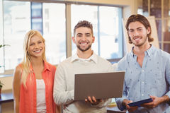 Happy business people using laptop Royalty Free Stock Image