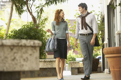 Happy Business People Walking On Sidewalk Stock Photography