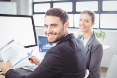 Happy business people working at computer desk Royalty Free Stock Photography