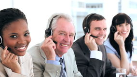 Happy business people working with headsets Royalty Free Stock Photos