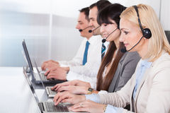 Happy Business People Working On Laptop Royalty Free Stock Photography