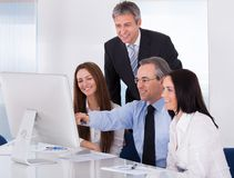 Happy business people working Stock Photo