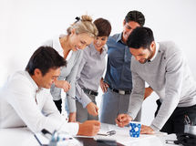 Happy business people working together Royalty Free Stock Photos