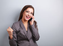 Happy business successful excited woman talking on mobile phone Stock Images