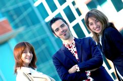 Happy Business Team. Smiling happy young business team infront of office building Royalty Free Stock Photo