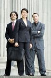 Happy Business Team. A young business team standing together in front of an old building Stock Photography