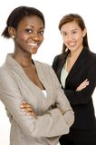 Happy Business Team. Two smiling attractive young business women on white background Royalty Free Stock Photography