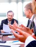 Happy business team applauding Royalty Free Stock Photos