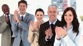 Happy business team applauding together Stock Image