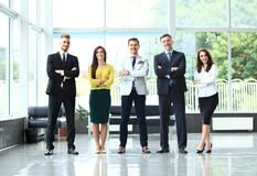Happy business team with arms crossed at the office. Happy business team with arms crossed at the office Royalty Free Stock Images