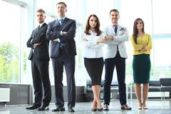 Happy business team with arms crossed at the office. Happy business team with arms crossed at the office Royalty Free Stock Photos