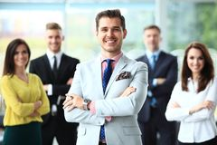 Happy business team with arms crossed at the office. Happy business team with arms crossed at the office Royalty Free Stock Photography
