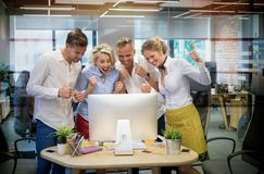 Happy business team celebrate success at work Stock Image