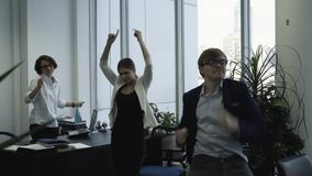 Happy business team celebrating Christmas and dancing in office. Corporate party. stock footage