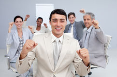 Happy business team celebrating a sucess. In the office Royalty Free Stock Image