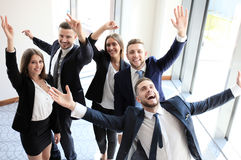 Happy business team. Celebrating victory in office Stock Images