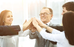 Happy business team celebrating victory in office Stock Photos