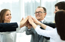 Happy business team celebrating victory in office Royalty Free Stock Images