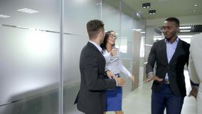 Happy business team celebrating victory in office. Happy business team celebrating victory in office stock footage